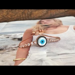 f9c1593982a204 Jewelry - Mother of pearl evil eye tennis bracelet